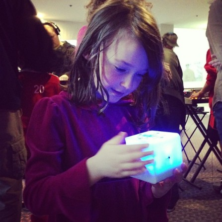 What an wesome photo by the Bob Moog Foundation. It really shows off how engaging the AudioCubes are. In ths photo this young lady is controlling effects using proximity via IR sensors.