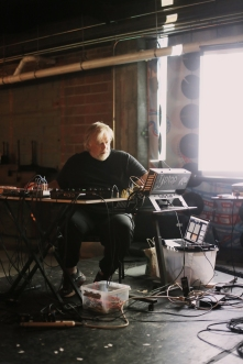 Darwin Grosse performing with (no)poem in Des Moines - Photo by Eva Lewin