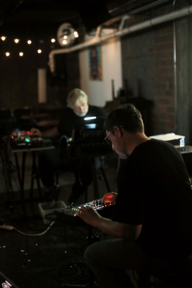 Mark Mosher and Darwin Grosse performing as (no)poem in Des Moines - photo by Eva Lewin